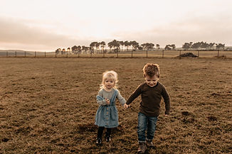 Brother and sister walking through field.jpg