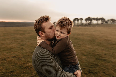 Father kissing son on cheek.jpg