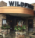 Wildfire Lincolnshire front entrance sign with beautiful winter planters