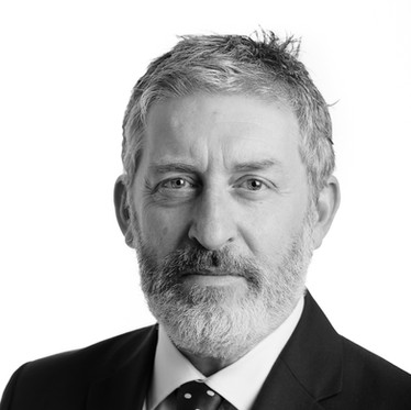 Black and white corporate portrait of a male