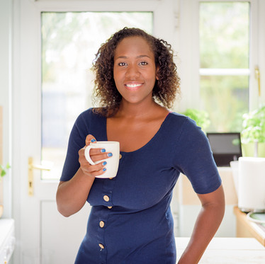 Lifestyle personal branding portrait of a female professional in the kitchen with a coffee for the Mortgage Mum