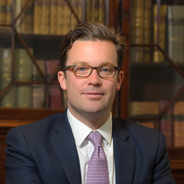 Environmental corporate portrait of a male lawyer in a London law firm office