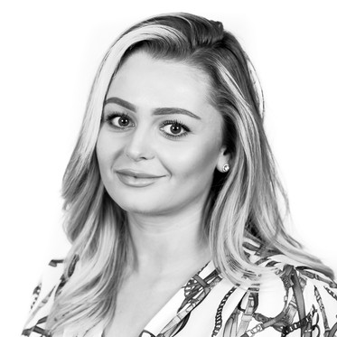 Black and white corporate portrait of a female professional against a white background