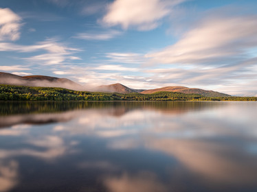 Reflections in Loch Morlich in the Cairngorms, Scotland
