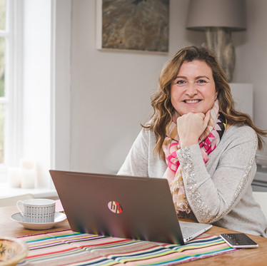 Lifestyle personal branding portrait of a female professional working on a laptop for the Mortgage Mum