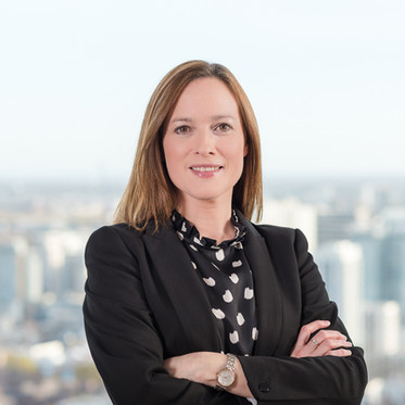 Environmental corporate portrait of a female professional in a London office boardroom