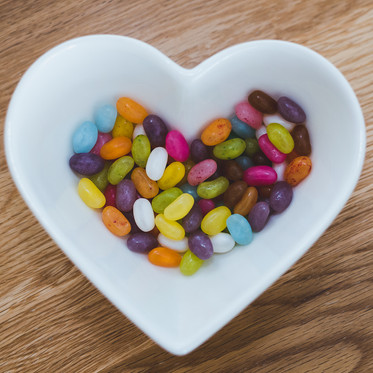 Personal branding product flatlay of jellybeans in a heart shaped bowl