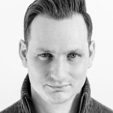 Black and white personal branding studio portrait of a male