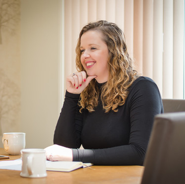 Lifestyle personal branding portrait of a female financial consultant working in the home