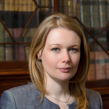 Environmental corporate portrait of a female lawyer in a London law firm office