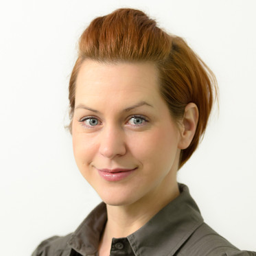 Corporate portrait of a female professional in studio style against a neutral background