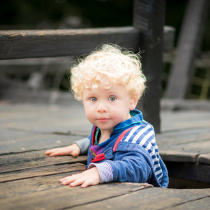 Lifestyle child portrait of young boy playing in outdoor playground