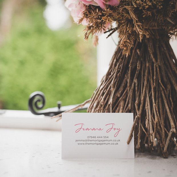 Personal branding product photograph of a business card next to a bouquet of dried flowers