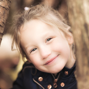 Lifestyle child portrait of young girl outdoors in the woods in autumnLifestyle child portrait of young girl outdoors in the woods in autumn