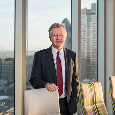 Environmental corporate portrait of a male professional in a London office boardroom