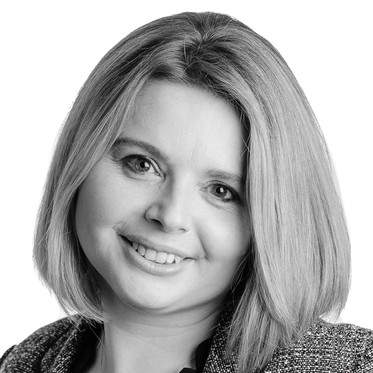 Black and white corporate portrait of a female lawyer against a white backgroun