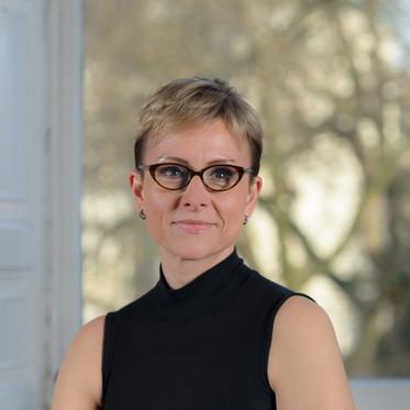 Environmental corporate portrait of a female lawyer taken in a London law firm office