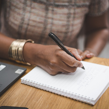 Personal branding details photograph of someone writing in a notepad