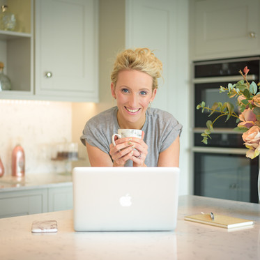 Lifestyle personal branding portrait of a female professional working in the kitchen for the Mortgage Mum