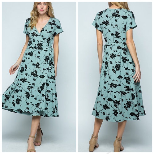 Turquoise dress with black flowers