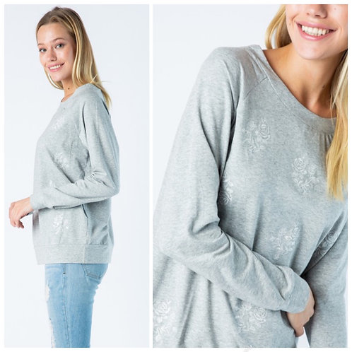Grey sweater with floral design