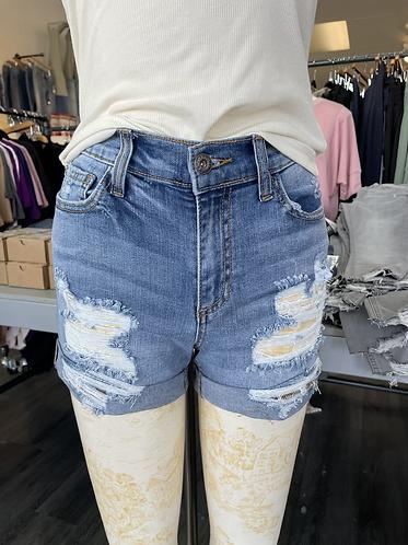 Sneak peek Mid rise distressed denim shorts
