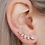 Thumbnail: Gold climber earrings