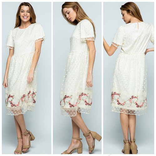 Natural poka dress with floral detail
