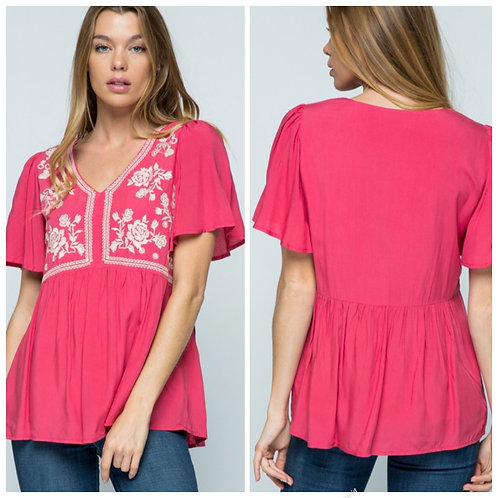 Pink blouse with embroidery