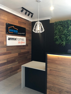 Stunning feature timber wall on entry and custom designed Reception desk with feature lighting