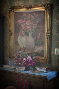 Oil painting of florals with gold frame