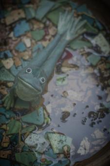 A metal garden frog outside the Institute's front door