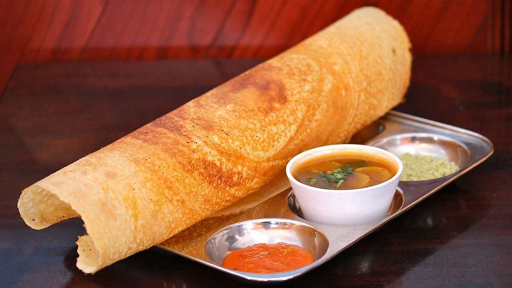 dosa served with sambar and chutney