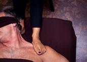 Ashiatsu barefoot massage using feet