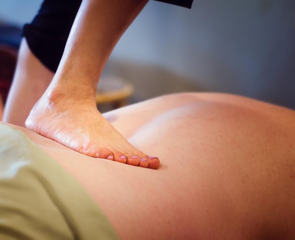 Back massage using feet