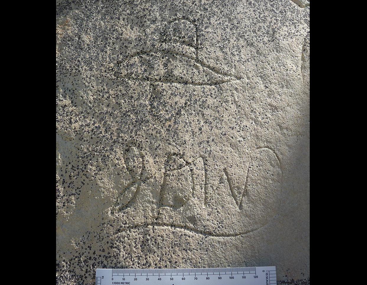 Inscriptions of cowboy hat and initials