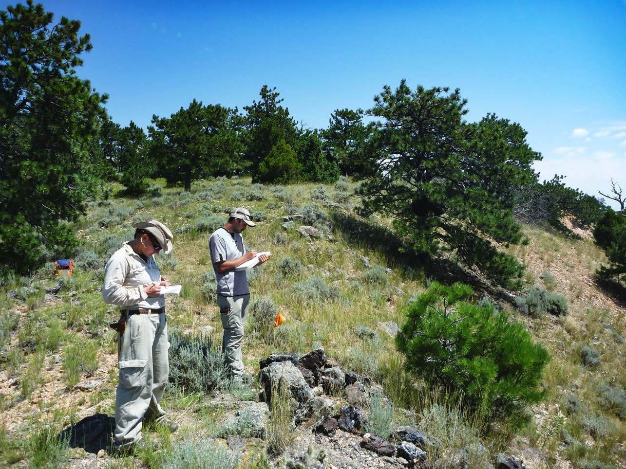 Documenting Native American hunting blind feature on ridge crest
