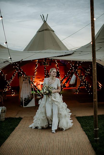 Bride outside Tipi Wedding venue