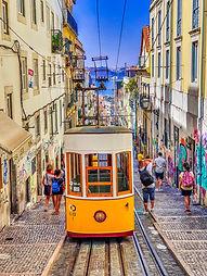people-walking-on-street-near-yellow-tra