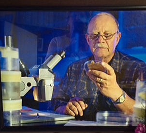 Olson with microscope.jpg