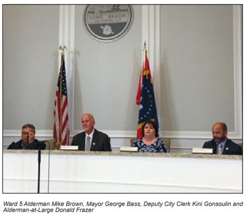 Ward 5 Alderman Mike Brown, Mayor George Bass, Deputy City Clerk Kini Gonsoulin and Alderman-at-Large Donald Frazer