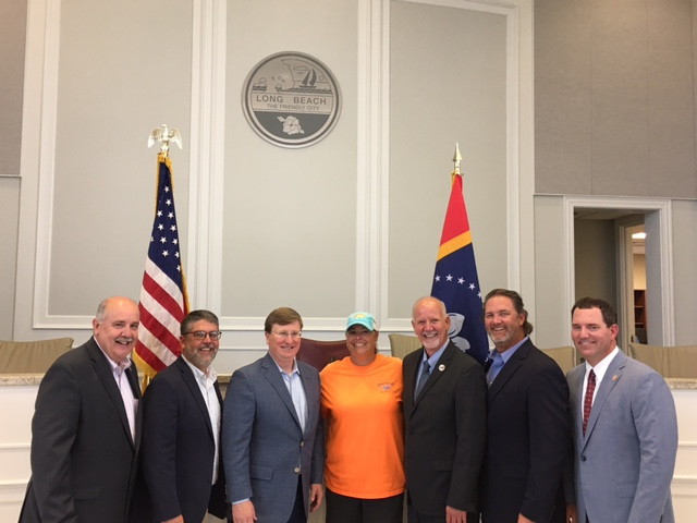 Photo by Dom Fimiano Pictured (l to r) are Richard Bennett, State Representative, District 120; Jay McKnight, State Representative, District 95; Governor Tate Reeves; Jennifer Moran, founder of Jeepin' the Coast; Mayor George Bass; Scott Delano, State Senator District 50; and Kevin Felsher, State Representative, District 117.