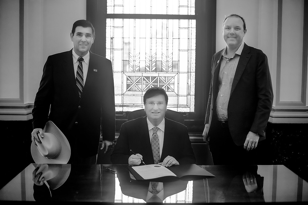 Andy Gipson, Tommy Stansell, and Governor Tate Reeves