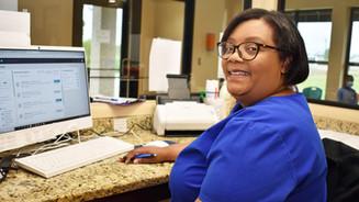 Pratmus Henson at her desk.jpg