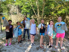Girl Scouts clean up local park