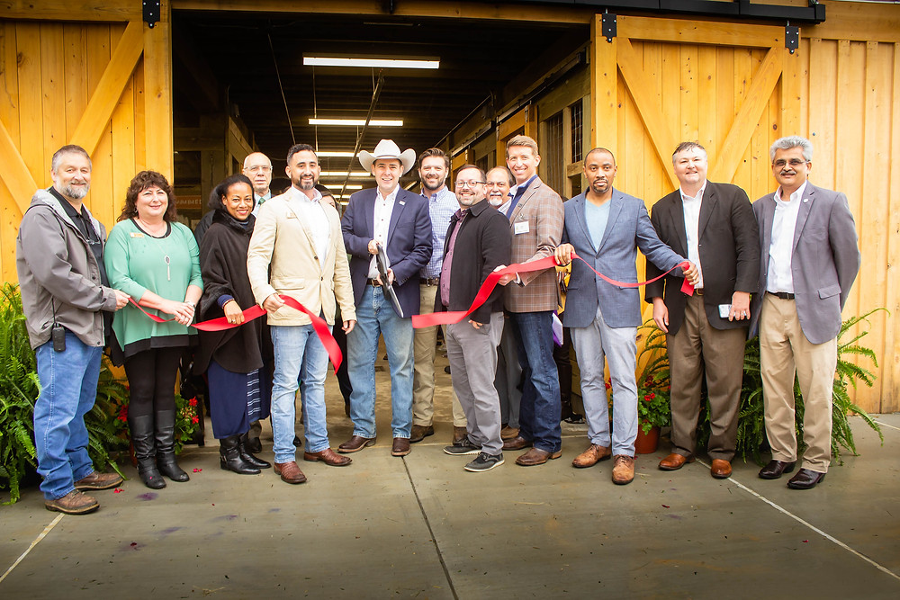 Commissioner of Agriculture and Commerce Andy Gipson (center) and Mississippi Agriculture and Forestry Museum Director Hayes Patrick (left of Commissioner) were joined by community leaders and museum staff to cut the ribbon at the new Children's Barnyard and Multipurpose Building at the Mississippi Agriculture and Forestry Museum. The Children's Barn, which houses a variety of farm animals, features 10 stalls, a turnout area, chicken coop, hay loft, tack room, and veterinary medicine exhibit.