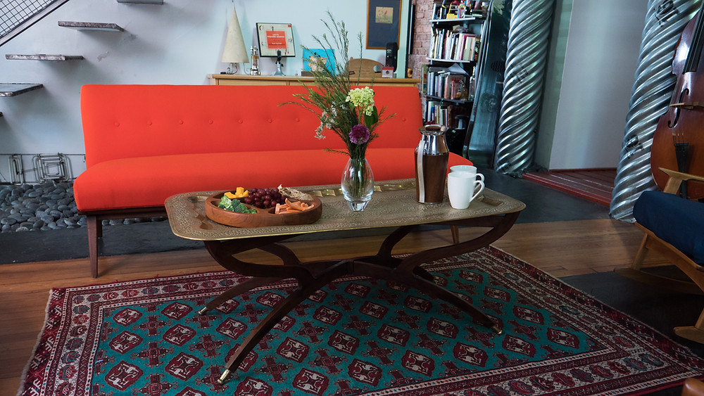 Vintage Jens Risom Banquette Sofa, Moroccan brass table, Quistgard server and more.