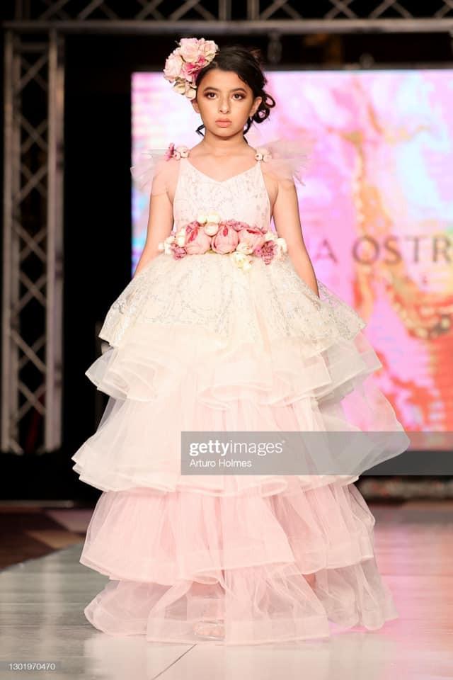 Miss Jr. Cuba U.S. 2020, Brielle Trujillo modeling Adrianna Ostrowska at NYFW