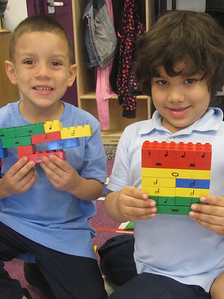 Two WHA students building with Duplo blocks.