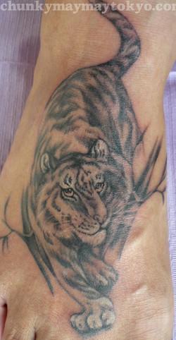 tiger on foot tattoo.jpg